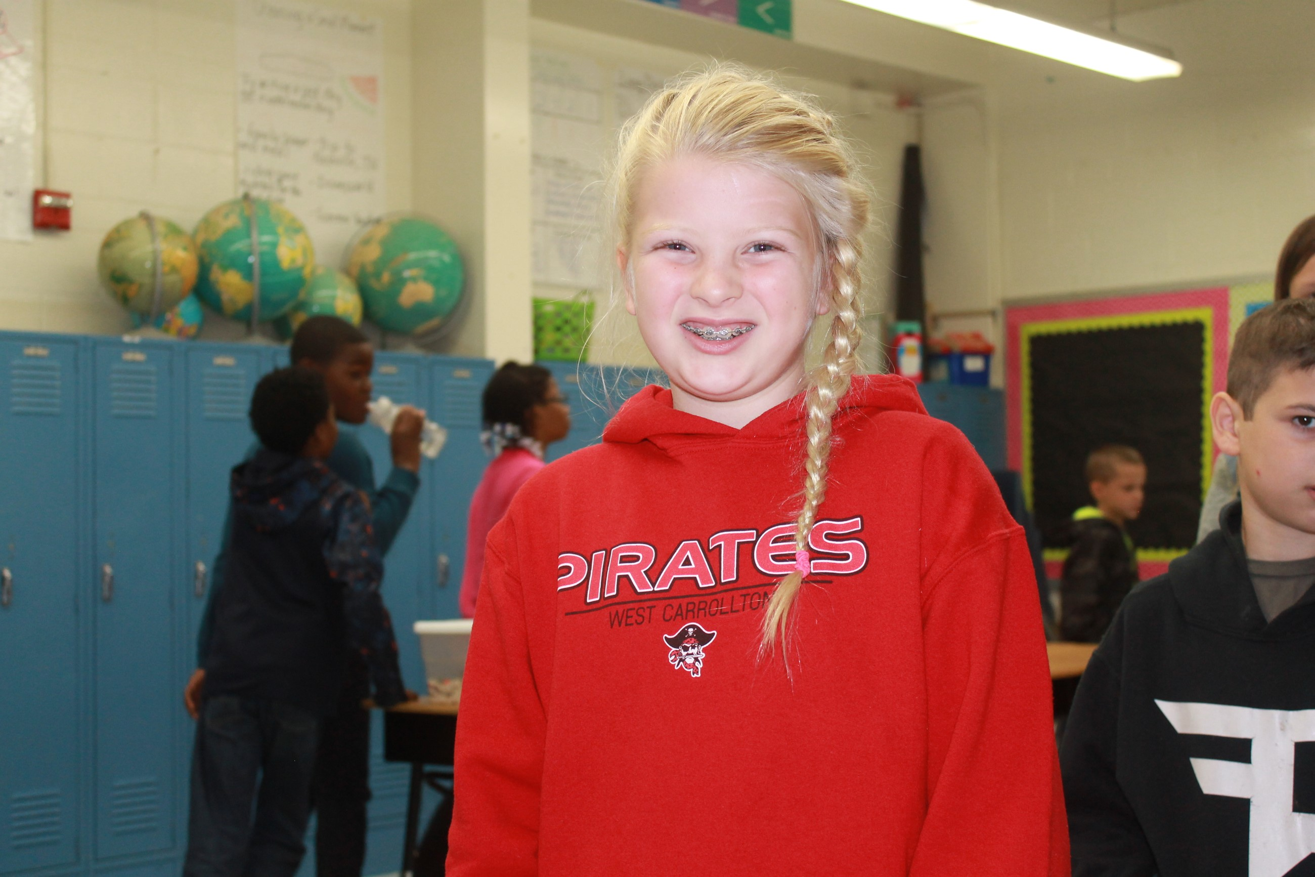 Girl Smiling with Pirate Shirt