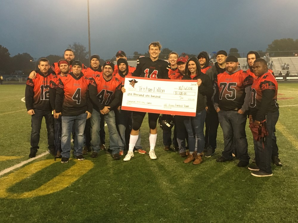 T. Dillon Receives Check from Alumni