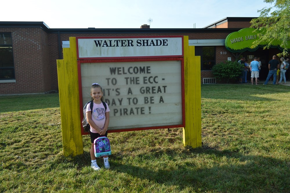 Girl Standing at the ECC Sign