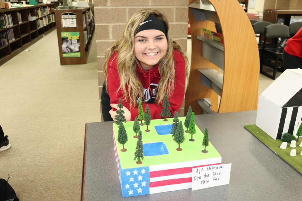 Middle School Girl with Monument Mall Project