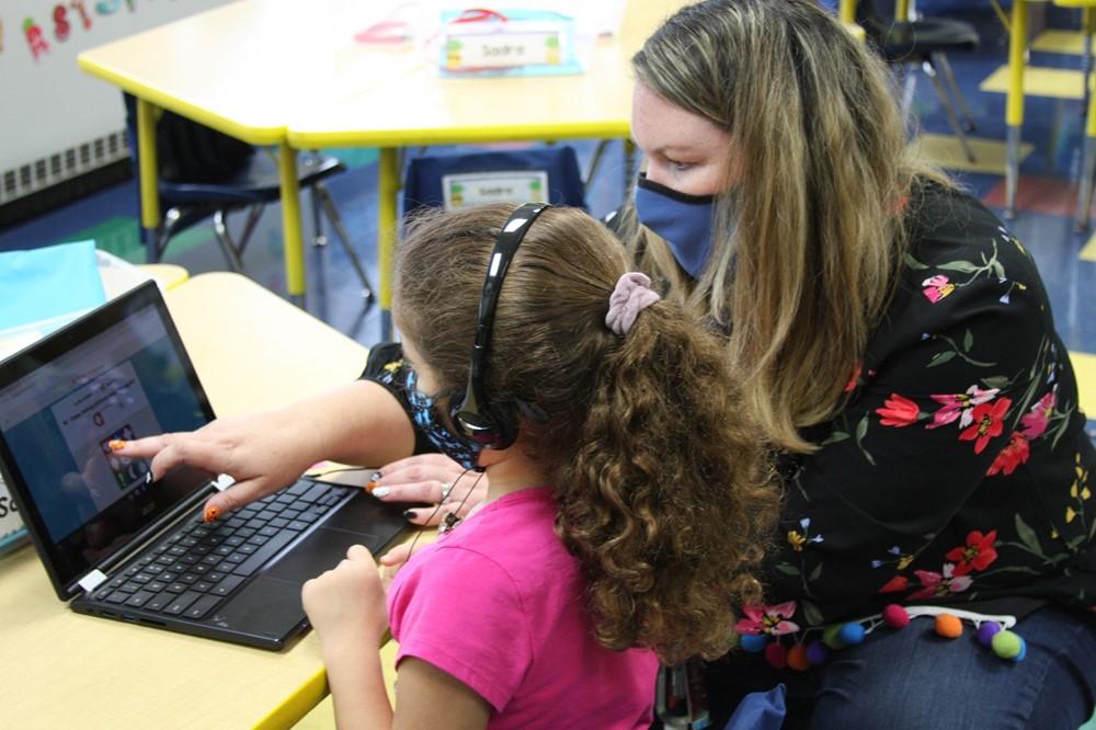 Kindergarten Teacher with Student
